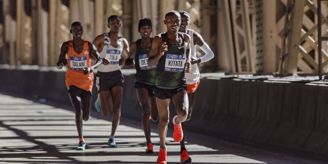 Tola Shura Kitata, of Ethiopia, front, runs with the men's pack as they cross the Queensboro bridge during the New York City Marathon in New York, Sunday, Nov. 4, 2018.